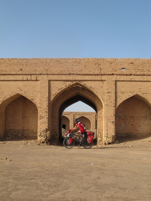 Cycling out of the abandoned caravanserai where I spent one night